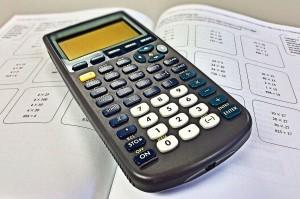 Close up of calculator on top of a math book