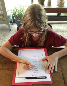 Girl doing a word exercise at home