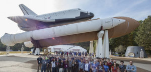 Class standing in front of space shuttle